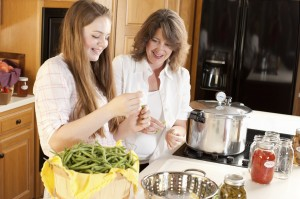 Canning: Caucasian Mother Teenage Daughter Preserving Homegrown