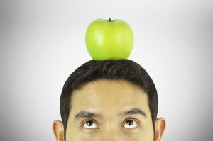 A man thinking with apple on the head